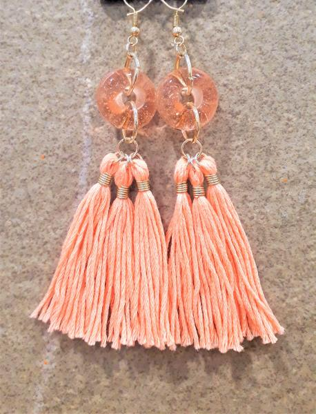 transparent pink glass beads with handmade pink tassels