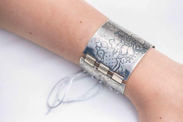 wide silver cuff with floral patterning