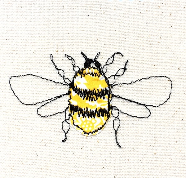 Free-machine embroidered & appliqued bee