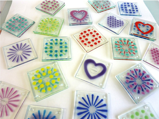 A selection of fused glass coasters